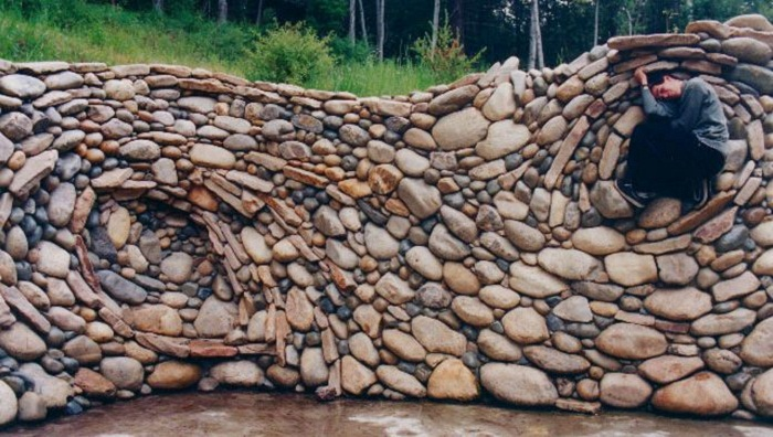 The art of the dry stack stone wall insteading for How to build a river rock patio